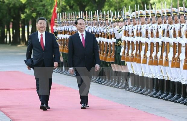 Le president Tran Dai Quang recu en grand pompe par son homologue chinois Xi Jinping hinh anh 1