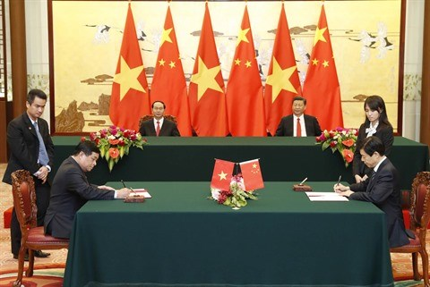 Le president Tran Dai Quang acheve une visite fructueuse en Chine hinh anh 2