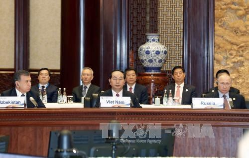 Le president Tran Dai Quang acheve une visite fructueuse en Chine hinh anh 3