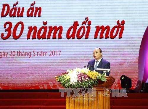 """Le PM au programme """"Gloire au Vietnam - 30 ans de renouveau"""" hinh anh 1"""