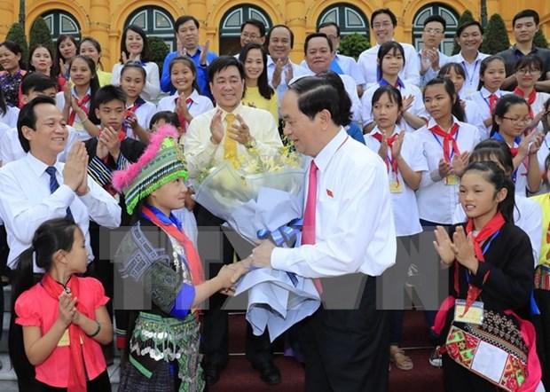 Le president Tran Dai Quang recoit des enfants en situation difficile hinh anh 1