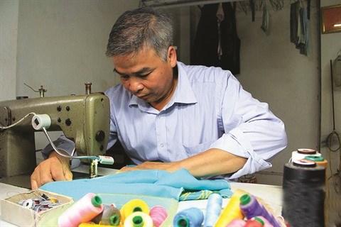 Le village de couture des tuniques de Trach Xa, l'empire du male hinh anh 3
