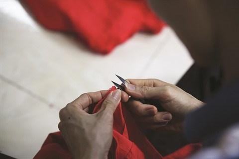 Le village de couture des tuniques de Trach Xa, l'empire du male hinh anh 5