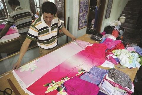 Le village de couture des tuniques de Trach Xa, l'empire du male hinh anh 2