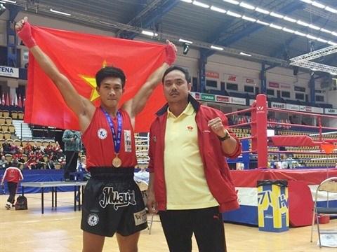 Duy Nhat, septuple champion du monde de Muay Thai hinh anh 1