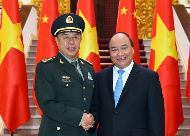 Le leader du PCV et le PM recoivent le vice-president de la Commission militaire centrale chinoise hinh anh 2