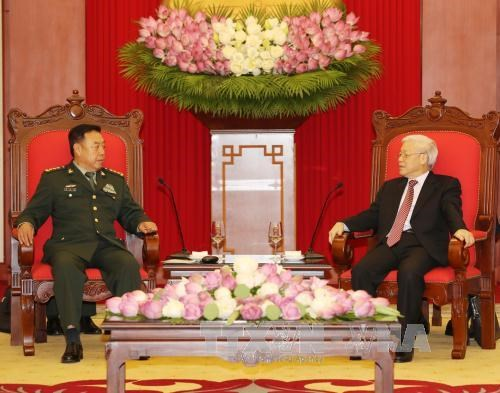 Le leader du PCV et le PM recoivent le vice-president de la Commission militaire centrale chinoise hinh anh 1