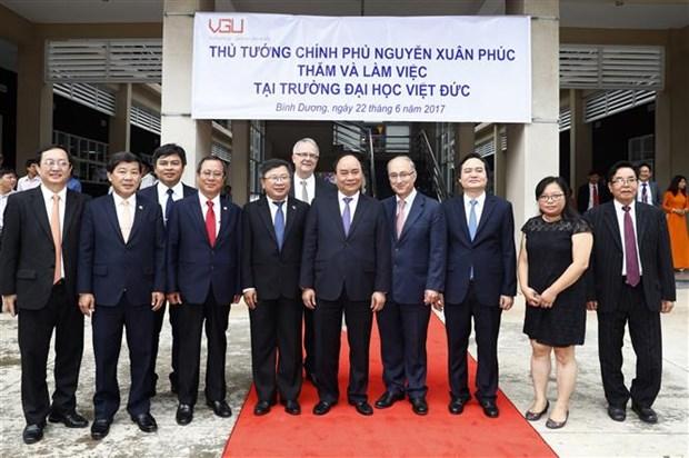 Le Premier ministre Nguyen Xuan Phuc travaille avec l'Universite Vietnam-Allemagne hinh anh 1