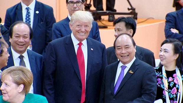 Le PM vietnamien rencontre les presidents chinois et americain a Hambourg hinh anh 1