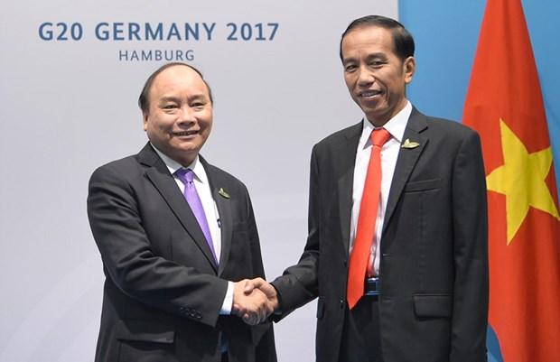 Le PM Nguyen Xuan Phuc rencontre le president indonesien et le PM indien hinh anh 1