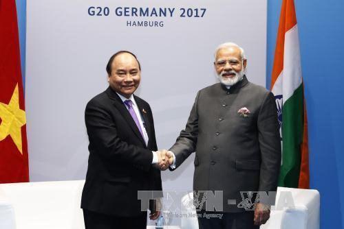Le PM Nguyen Xuan Phuc rencontre le president indonesien et le PM indien hinh anh 2