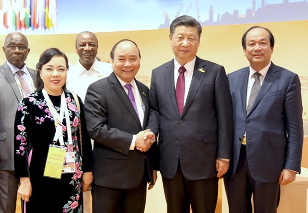 Le PM vietnamien rencontre les presidents chinois et americain a Hambourg hinh anh 2