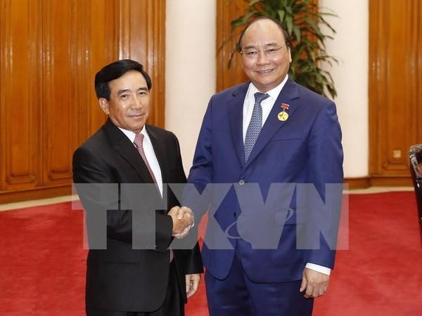 Les dirigeants vietnamiens recoivent le vice-president laotien Phankham Viphavanh hinh anh 3