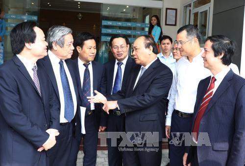 Le chef du gouvernement presse d'accelerer le projet d'Universite nationale du Vietnam hinh anh 2