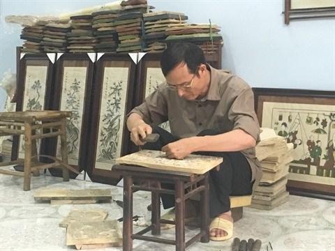 Dong Ho, des estampes populaires et des hommes hinh anh 4