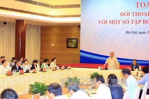 Le Premier ministre Nguyen Xuan Phuc dialogue avec le secteur prive hinh anh 2