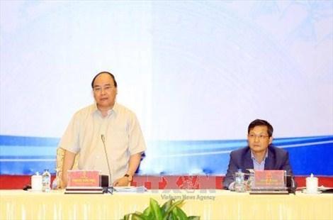 Le Premier ministre Nguyen Xuan Phuc dialogue avec le secteur prive hinh anh 1