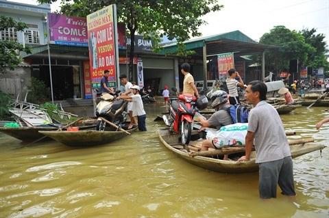 Debat sur les impacts des inondations du Vietnam a Paris hinh anh 2