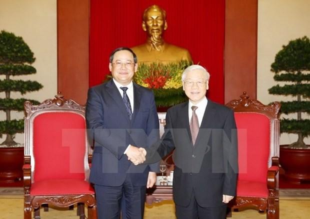 Le secretaire general Nguyen Phu Trong recoit le vice-Premier ministre laotien Sonexay Siphandone hinh anh 1