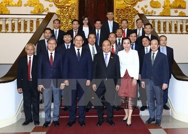 Le Premier ministre demande d'augmenter le commerce bilateral avec le Laos hinh anh 1
