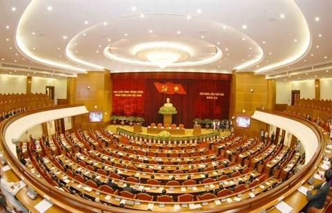 Le leader du PCV signe la promulgation de trois resolutions adoptees par le 6e Plenum hinh anh 2