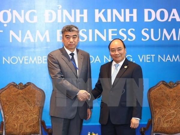 APEC 2017 : le PM recoit des hommes d'affaires etrangers hinh anh 1
