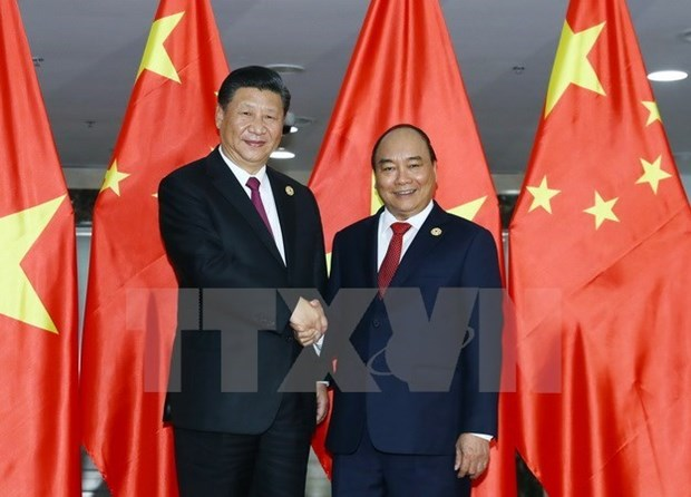 Le PM Nguyen Xuan Phuc rencontre le leader chinois Xi Jinping hinh anh 1