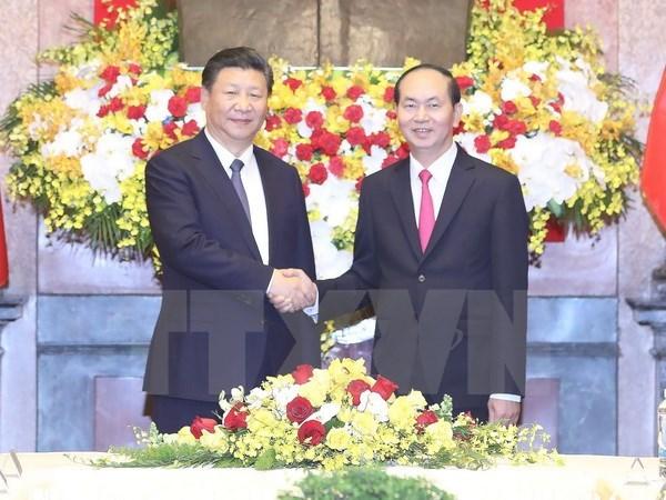 Entretien entre les presidents Tran Dai Quang et Xi Jinping hinh anh 1