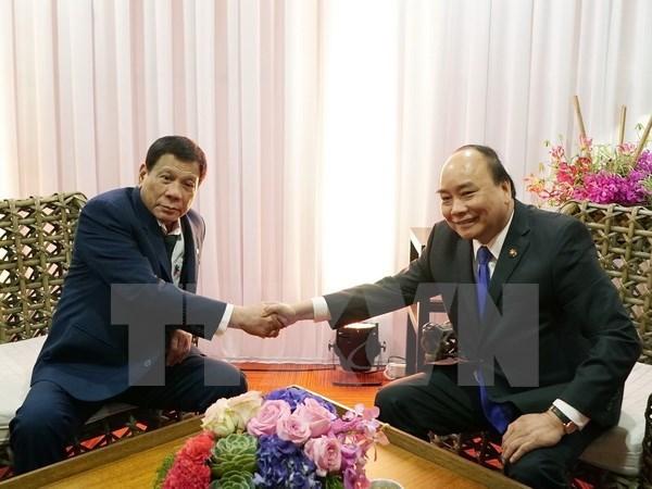 Le PM rencontre les dirigeants russe et philippin en marge du sommet de l'ASEAN hinh anh 2
