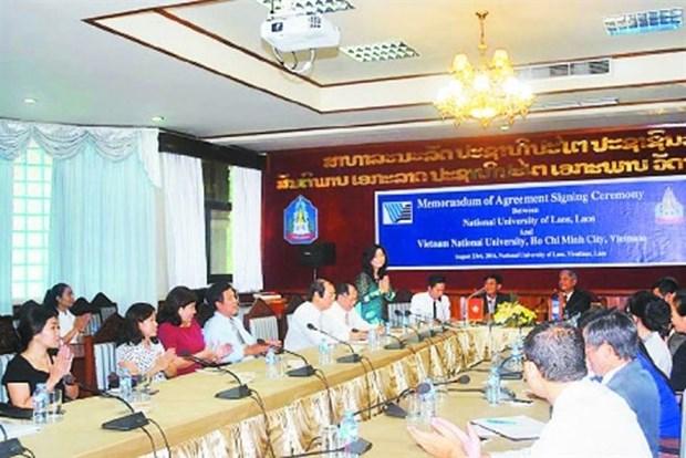 Colloque Vietnam-Laos sur la protection des valeurs culturelles traditionnelles hinh anh 1