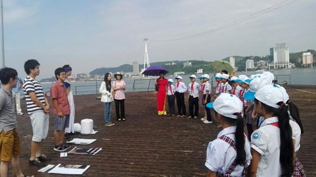 La preservation de la baie de Ha Long entre a l'ecole hinh anh 1