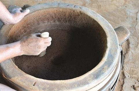 Les fondeurs de bronze de Phuoc Kieu gardent la flamme hinh anh 2