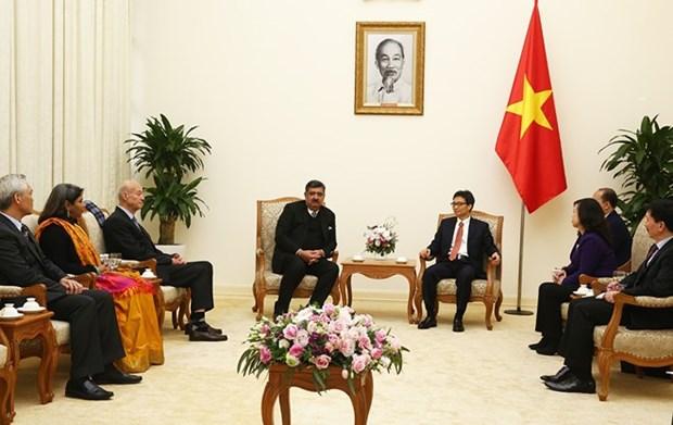 Le vice-PM Vu Duc Dam recoit la delegation du village SOS international des enfants hinh anh 1