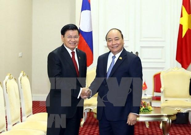 Developpement profond et efficace des liens Vietnam-Laos hinh anh 1