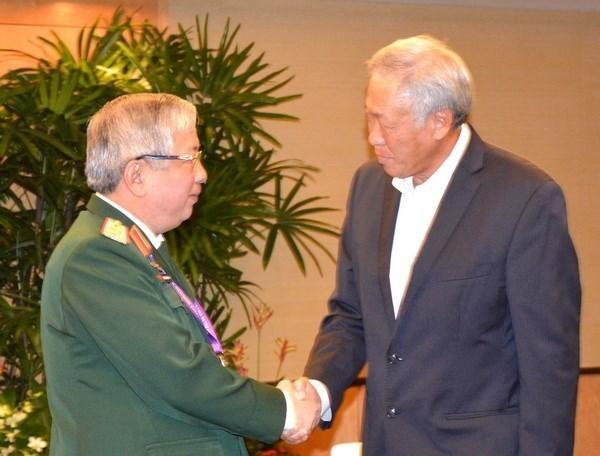 Le general Nguyen Chi Vinh rencontre les ministres singapourien et chinois de la Defense hinh anh 1