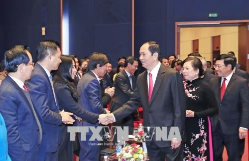Le president Tran Dai Quang salue les Vietnamiens de l'etranger hinh anh 3