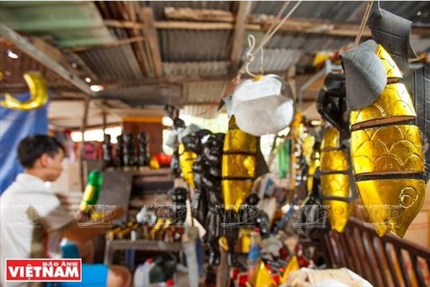 L'artisan qui amene les marionnettes sur l'eau au Sud hinh anh 2