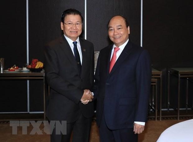 Sommet ASEAN-Australie: le PM Nguyen Xuan Phuc rencontre son homologue laotien hinh anh 1