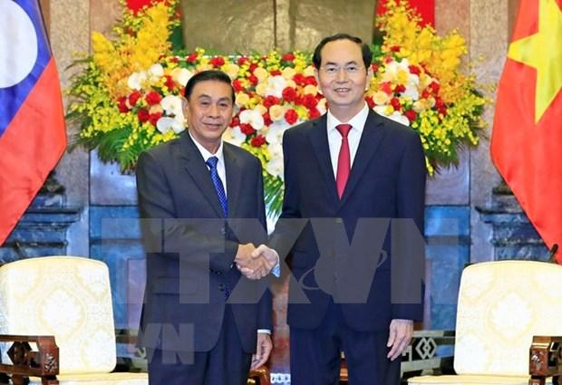 Le president Tran Dai Quang recoit le chef du bureau presidentiel laotien hinh anh 1