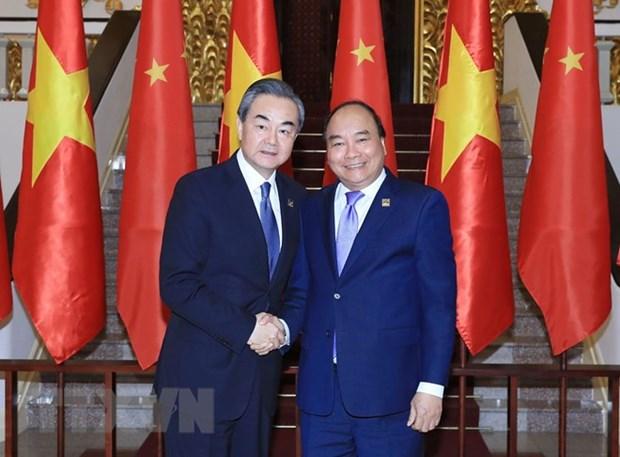 Le PM Nguyen Xuan Phuc recoit le ministre chinois des Affaires etrangeres Wang Yi hinh anh 1