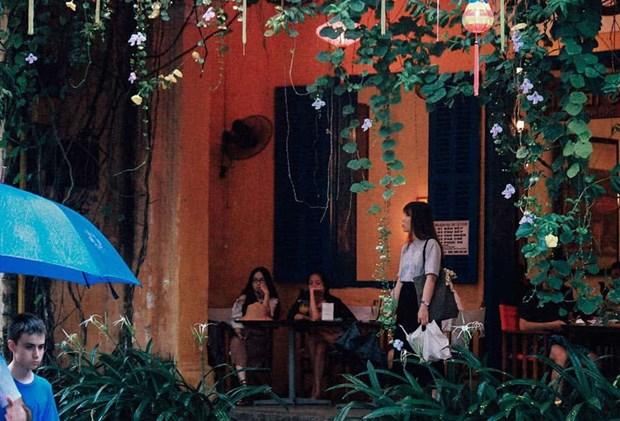 Dans la vieille ville de Hoi An, la pluie du matin rejouit le pelerin hinh anh 3