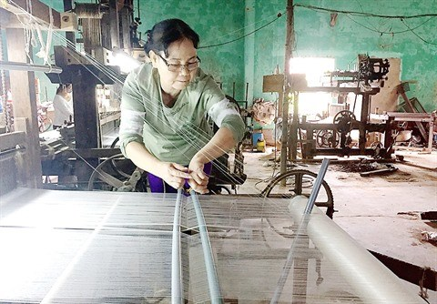Au village de la soie de Ma Chau, le metier a tisser la tradition hinh anh 1