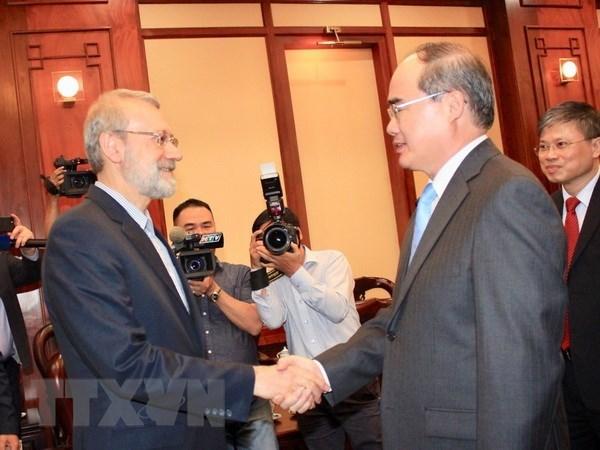 Le secretaire du Comite du Parti de HCM-Ville Nguyen Thien Nhan recoit Ali Ardeshir Larijani hinh anh 1