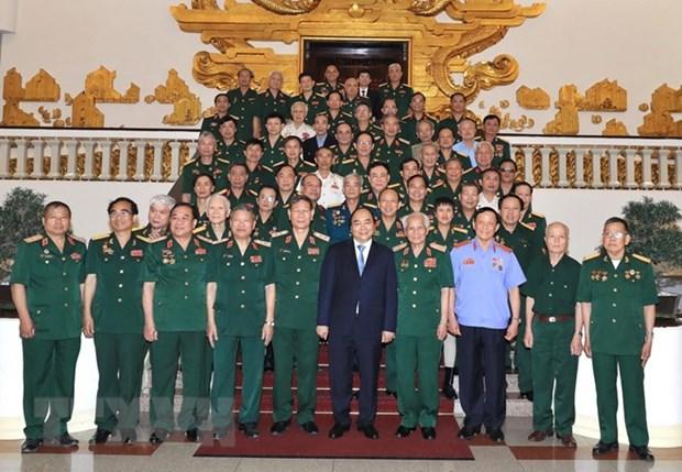 Le Premier ministre rencontre les anciens combattants du Front du Tay Nguyen hinh anh 1