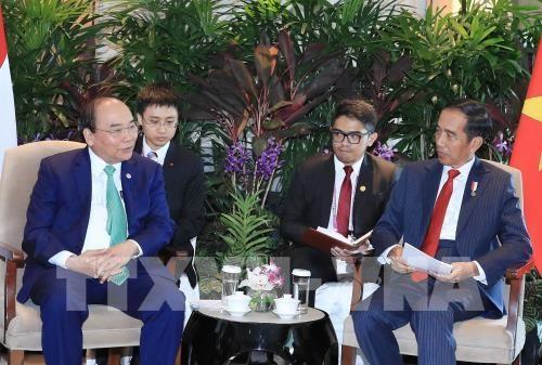 Le PM rencontre les presidents indonesien et birman a Singapour hinh anh 1