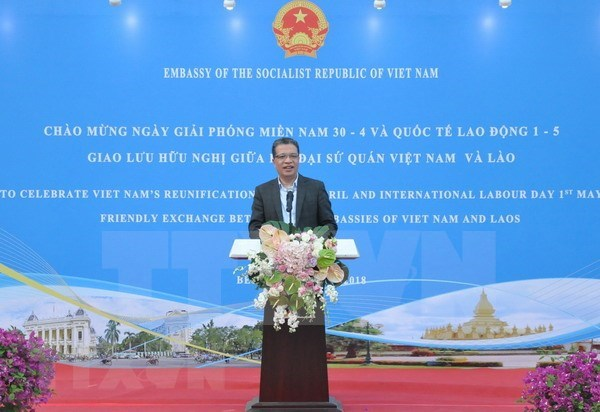L'echange d'amitie Vietnam - Laos en Chine hinh anh 1