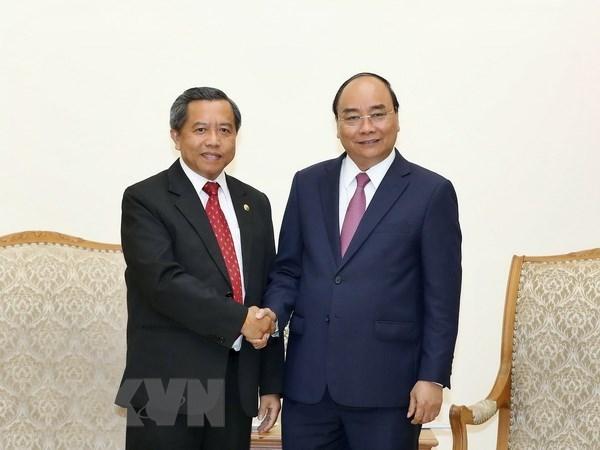 Le PM recoit le ministre laotien des sciences et des technologies hinh anh 1