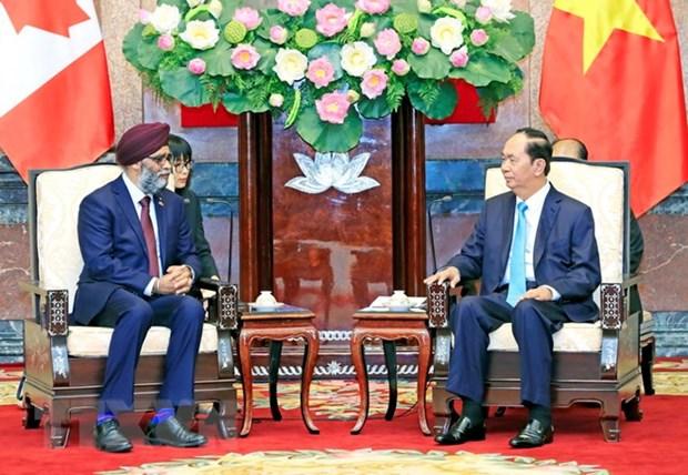 Le president Tran Dai Quang recoit le ministre canadien de la Defense hinh anh 1