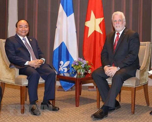 Le PM Nguyen Xuan Phuc rencontre le Priemier ministre de l'Etat du Quebec hinh anh 1