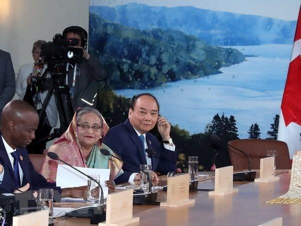 Un article de VNA sur la participation du Vietnam au Sommet du G7 elargi a publie au Canada hinh anh 1